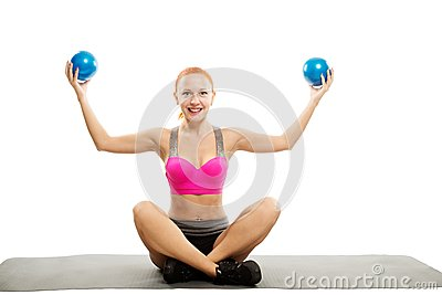 Beautiful sensual woman doing fitness with balls