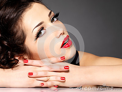 Beautiful sensuality woman with red nails and lips