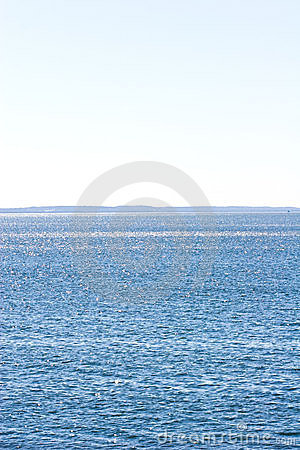 Beautiful serene blue sky and ocean waves horizon