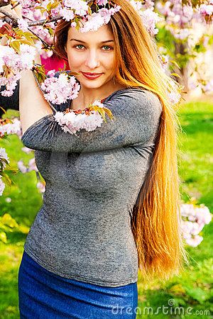 Beautiful serene woman and flower blossoms