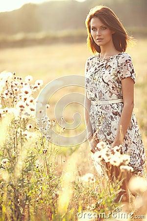 Beautiful sexy brunette woman outdoors on a sunset