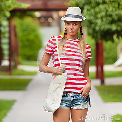 Free Beautiful Sexy Female In Jeans Shorts And Striped T-shirt, In Hat, Outdoors. Tanned Girl In Summer Stock Images - 53942004
