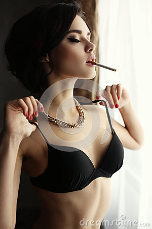 Sexy girl smoking cigarette Images and Stock Photos