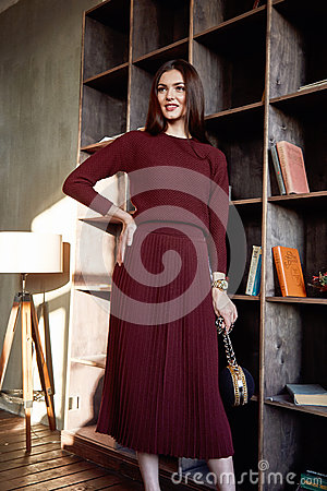Free Beautiful Sexy Woman Brunette Hair Fashion Model Wear Stylish Red Dress Wool Sweater Skirt Casual Collection Glamour Pose Studio Royalty Free Stock Photo - 84227455