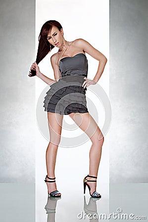 Beautiful sexy woman in glamour dress