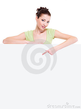 Beautiful sexy woman points on a white paper