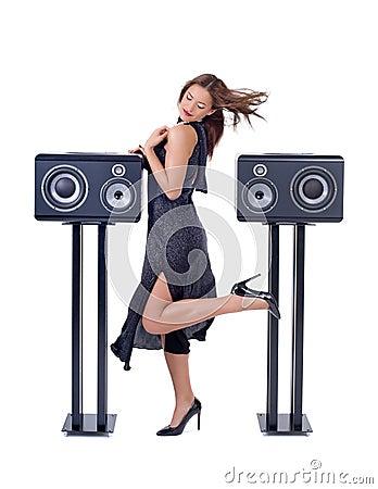 Beautiful sexy woman posing with audio equipment