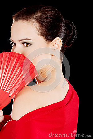 Beautiful sexy woman in red dress and fan.