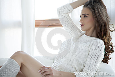 Beautiful and sexy woman in sweater