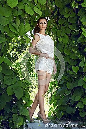 beautiful sexy woman wearing dress walk park sun shine makeup young brunette hair evening short suit top skirt high heels shoes 54944511