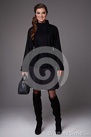 Free Beautiful Sexy Young Business Woman With Evening Make-up Wearing A Dark Skirt To The Knee Wool Red Coat Jacket High Boots High Hee Stock Photography - 48871742
