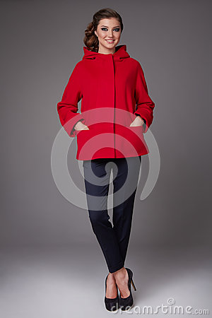 Free Beautiful Sexy Young Business Woman With Evening Make-up Wearing Pants Wool Coat Jacket High Boots High Heels And A Small Black Ha Royalty Free Stock Images - 48871749