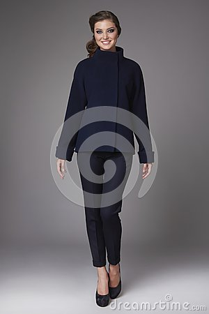 Free Beautiful Sexy Young Business Woman With Evening Make-up Wearing Pants Wool Coat Jacket High Boots High Heels And A Small Black Ha Stock Images - 48871964