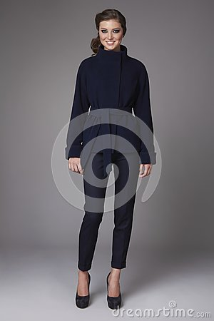 Free Beautiful Sexy Young Business Woman With Evening Make-up Wearing Pants Wool Coat Jacket High Boots High Heels And A Small Black Ha Stock Photos - 48871993
