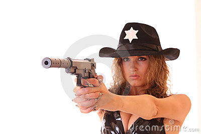 Beautiful sheriff woman shooting with gun