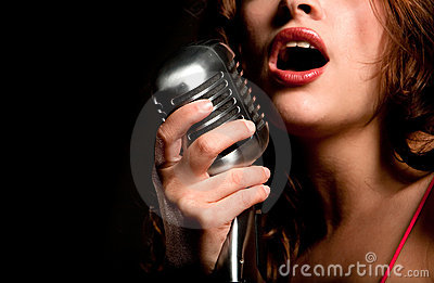 Beautiful singer girl singing with microphone