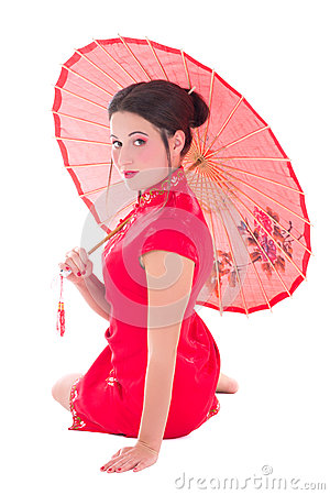 Beautiful sitting girl in red japanese dress with umbrella isola