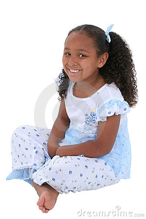 Beautiful Six Year Old Girl Sitting In Pajamas Over White