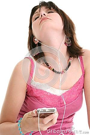 Beautiful Sixteen Year Old Girl Listening To Music