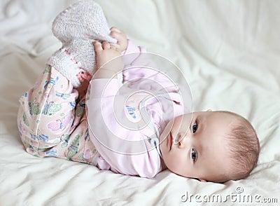 Beautiful small baby girl lying on