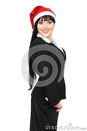 Beautiful smiley businesswoman in red santa hat