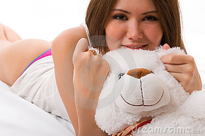 Beautiful smiling asian girl with a toy.