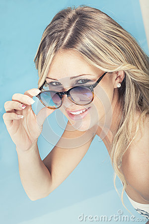 Free Beautiful Smiling Blonde Hair Girl With Sunglasses In The Pool. Stock Image - 53823521