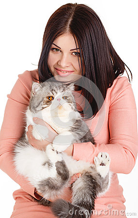 Beautiful smiling brunette girl and her big cat on a white background