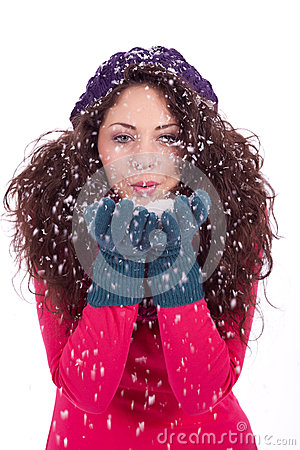 Beautiful smiling brunette woman in snow in winter