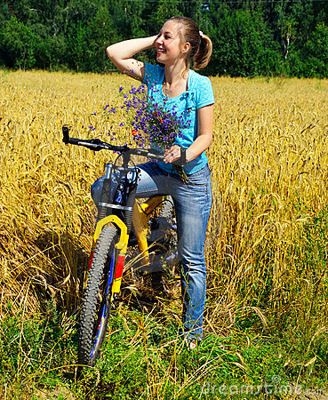 Beautiful smiling girl on bicycle