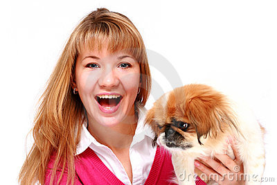 Beautiful smiling girl and little dog.