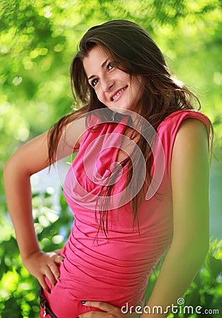 Beautiful smiling girl relaxing outdoor portrait