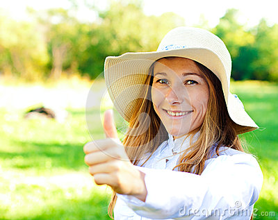 Beautiful smiling girl on summer day in hat