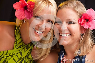 Beautiful Smiling Girls with Hibiscus Flower
