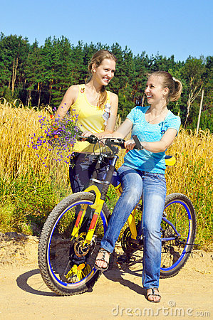 Beautiful smiling girls rest from ride bicycle