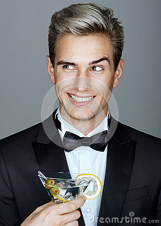 Free Beautiful Smiling Handsome Man In Black Suit With Glass Of Martini Royalty Free Stock Photos - 79049808