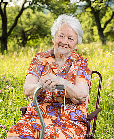 Free Beautiful Smiling Old Woman Sitting In The Chair Stock Photo - 54909400