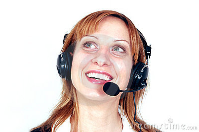Beautiful smiling redhead woman with headphones.