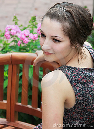 Beautiful smiling teen girl sitting