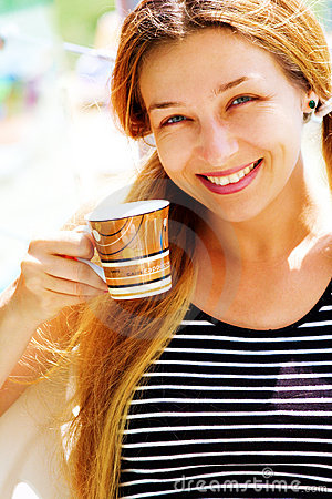 Beautiful smiling woman and coffee cup
