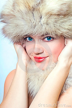 Beautiful smiling woman in fur hat