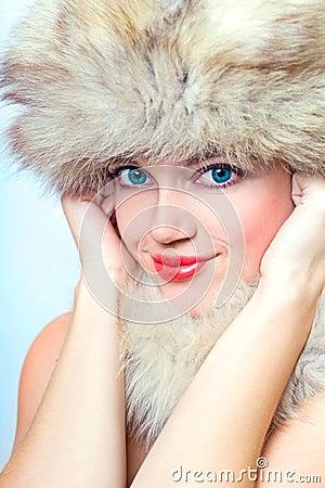 Beautiful smiling woman in fur hat