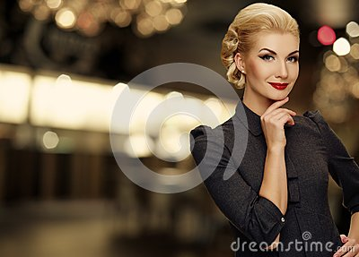 Beautiful smiling woman in grey dress
