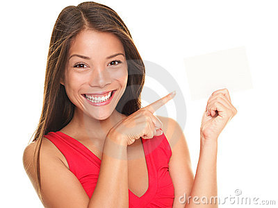 Beautiful smiling woman pointing at gift card