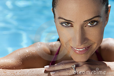 Beautiful Smiling Woman Relaxing In Swimming Pool