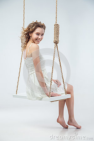 Free Beautiful Smiling Woman Sitting On Swing Isolated Royalty Free Stock Images - 49731079