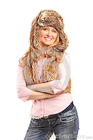 Beautiful smiling woman wearing fur hat