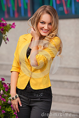 Free Beautiful Smiling Woman With Yellow Jacket And Blond Hair Posing Outdoor. Fashion Girl Stock Photography - 57667112