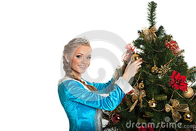 Beautiful Snow Maiden decorating Christmas tree