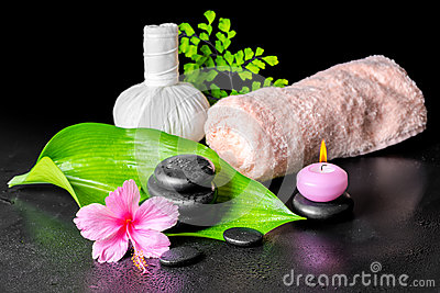Beautiful spa composition of pink hibiscus flower, leaves, thai Stock Photo